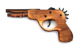 Toy wooden gun , on a white background
