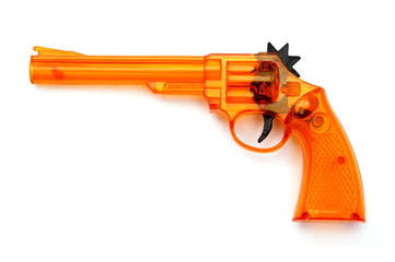 Toy plastic gun , on a white background