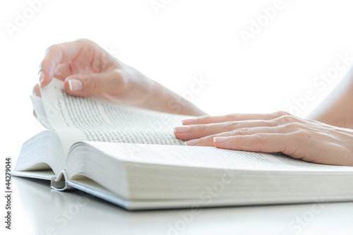Young female reading a big book