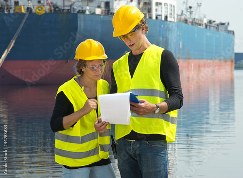 Dockers checking freight papers