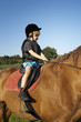 young boy ride a horse