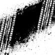 White tire track on black ink blots