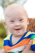 wonderful smiling baby boy with Down syndrome