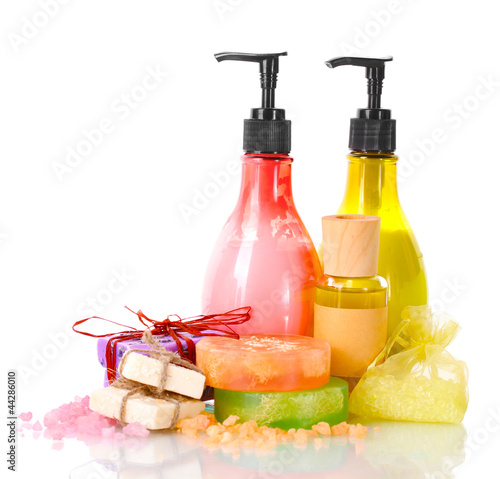 Bottles , soaps and sea salt isolated on white