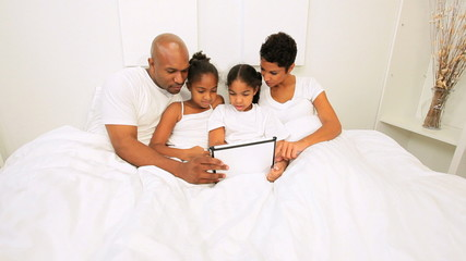 African American Family Wireless Tablet Bedroom