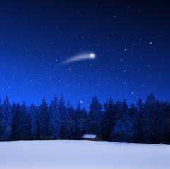 Verschneite Schihütte und Weihnachtsstern