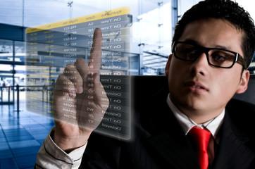 Business man chosing her flight at the airport on a digital futu