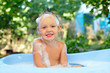 cute smiling baby boy in bubble bath outdoor