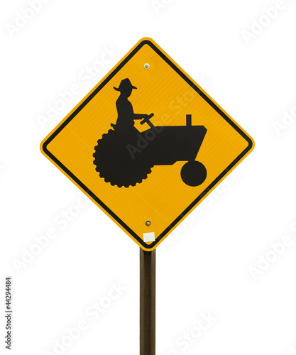 Yellow farm tractor sign