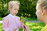 Mother and daughter gathering flowers in the park poster
