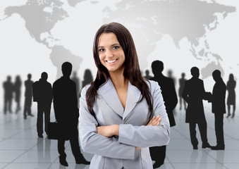 Happy young business woman standing in front of