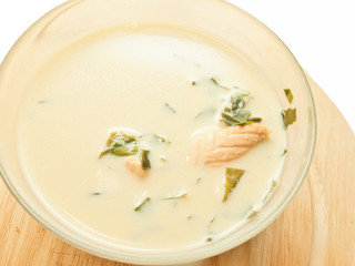 cream soup with salmon and weed over white