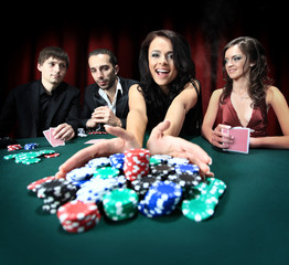 young beautiful woman playing in casino