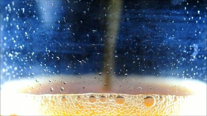 Pouring a glass of soda
