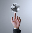 holding a glowing earth globe
