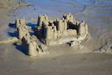 Fototapety sand castle collapsing by the tide on the coast of Brittany