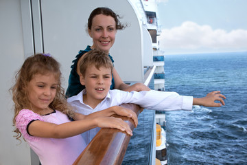 mother with her children travel on ship