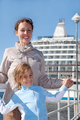 mother daughter smiling near ship in port of Tallinn