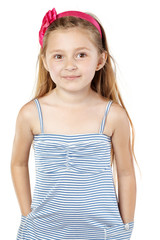 Little girl in striped sundress with red band in hair