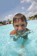 outdoor portrait of funny smiling child having fun in aquapark
