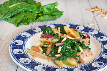 fresh salad with chard noodles and pine nuts
