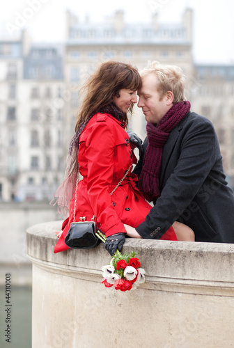 Beautiful romantic couple having a date in Paris