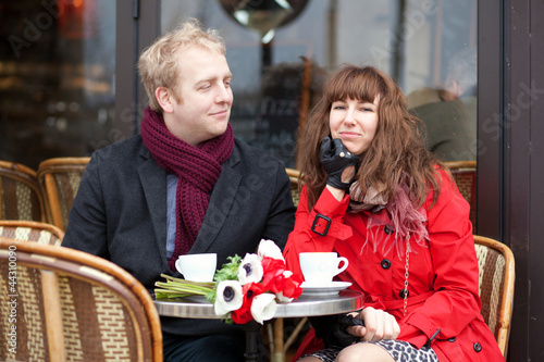 Happy couple having a date in cafe