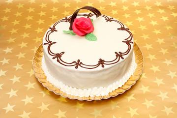 White cake on golden stars background