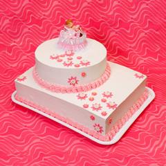 Christening cake for girl on pink background