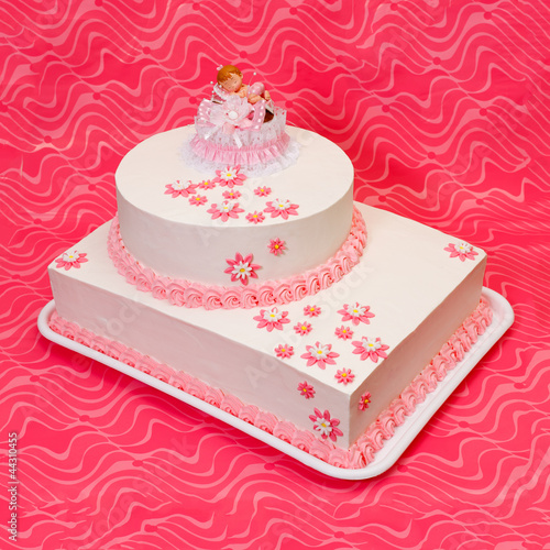 Christening cake for girl on pink background