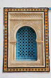 Window with islamic arch in a white tunisian building