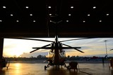 silhouette of helicopter in the hangar - Fine Art prints