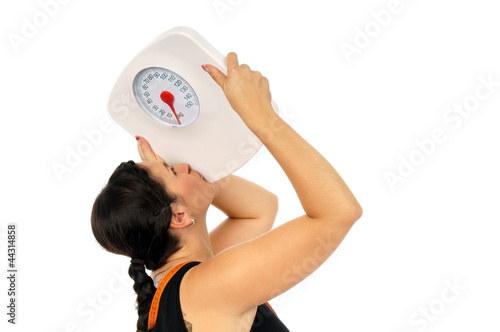 young woman kisses a weight scale