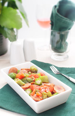 Bright salad with sausages and vegetables