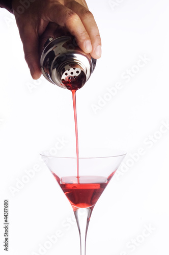 barman's hand with shaker liquor