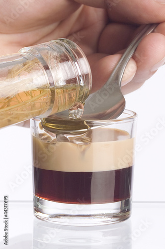 barman's hand with liquor