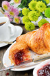 Breakfast with coffee, croissant and jam
