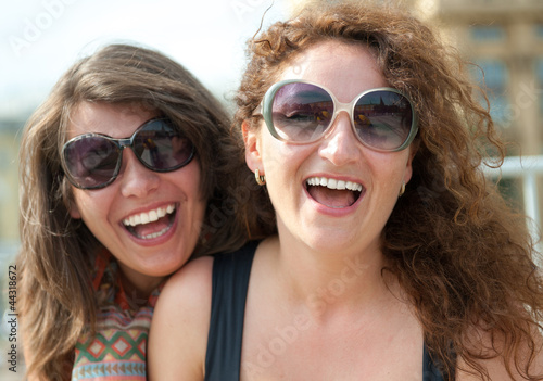 Two happy young beautiful women