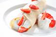 Crepe with cream and fresh strawberries