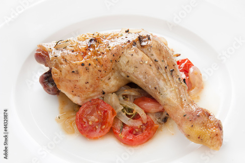 Roast chicken with tomatoes, onions and herbs
