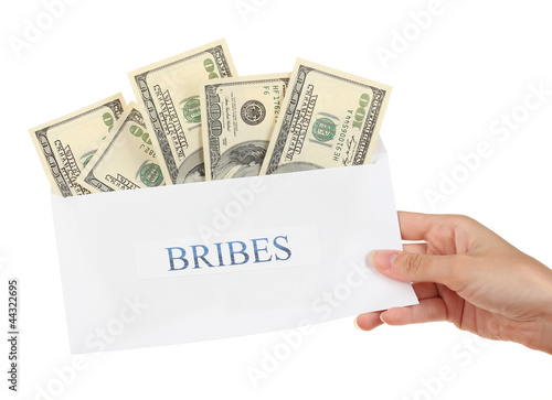 Woman's hand holding an envelope with money on white background