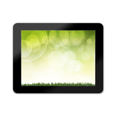 Green grass with background colorful in tablet Computer