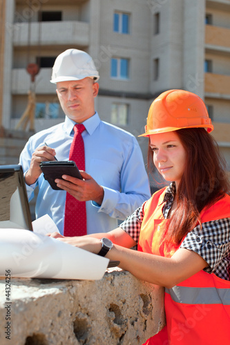 Two builders works at construction site