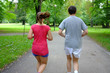 caucasian couple   jogging in summer park.