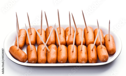 cocktail sausages; punctured tray with chopsticks