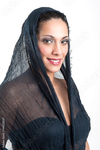 Veiled woman isolated against white background. Intense portrait
