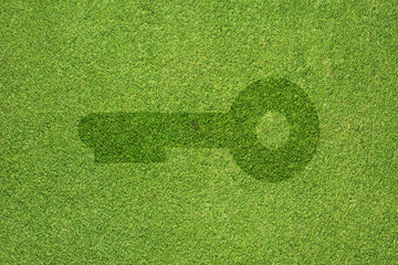 Key icon on green grass texture and  background