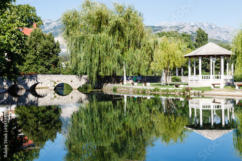 Picturesque Landscape, Stone Bridge, Pavilion, River and Willow,