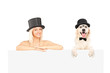 Female and dog with top hat posing behind white panel