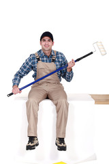 Man sat with paint roller